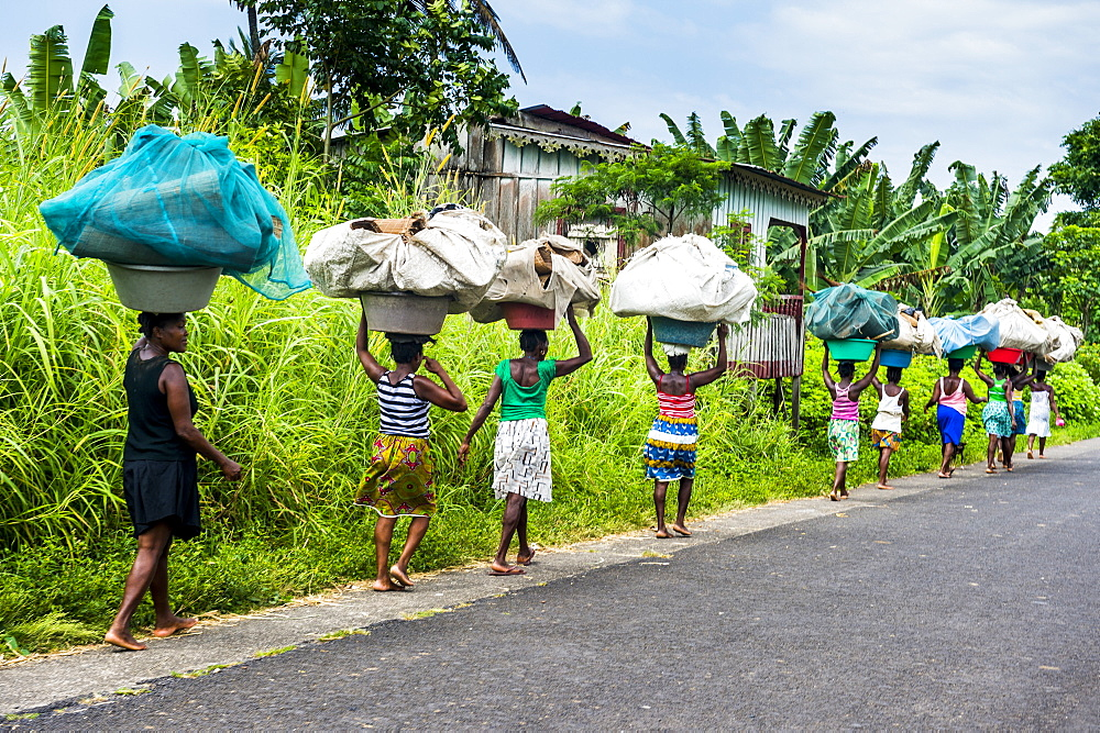 Women carrying giant baskets on their heads, northern Sao Tome, Sao Tome and Principe, Atlantic Ocean, Africa