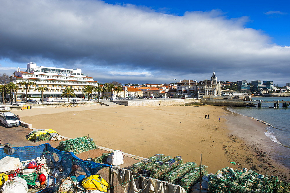 The beach of Praia do Peixe on the seafront of the seaside town of Cascais, Portugal, Europe