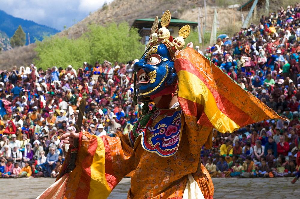 Traditionally dressed dancer at the Paro Tsechu, a religious dance ceremony, Paro, Bhutan, Asia