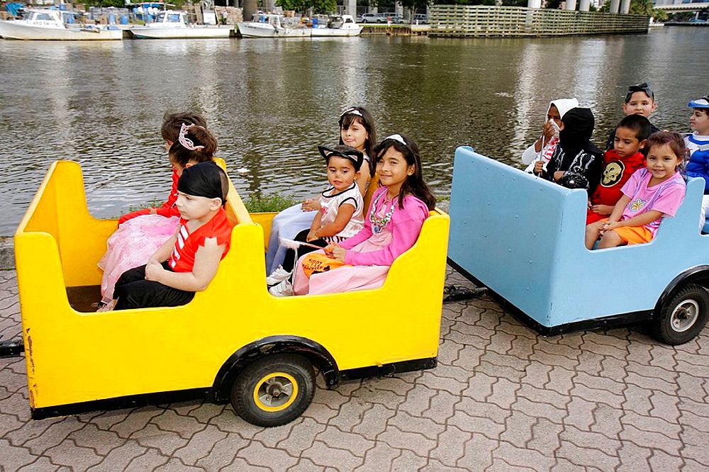Florida, Miami, Little Havana, Jose Marti Park, Halloween Festival, Hispanic, girls, boys, children, costume, holiday, tradition, trick-or-treat, kiddie train, amusement ride, Miami River,