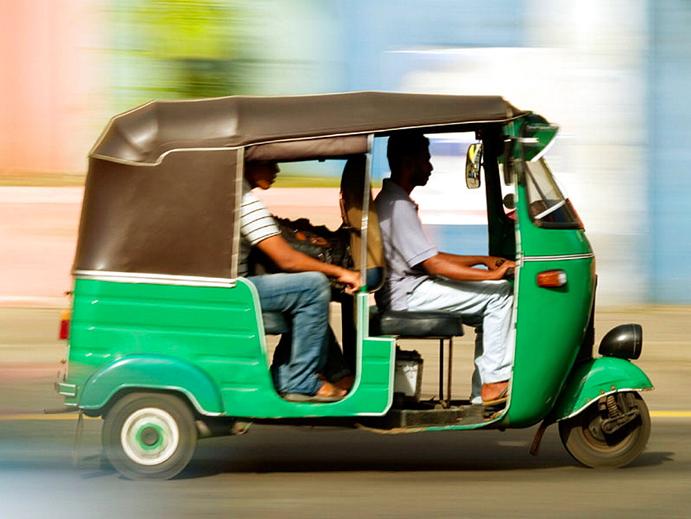 Three wheeled motorized taxi, known as an autorickshaw, in Colombo, Sri Lanka