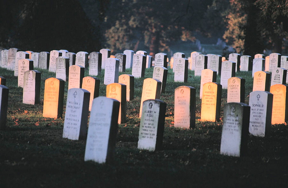 Gravestones at sunrise, shrine to those defending freedom, Arlington National Cemetery, Virginia, USA