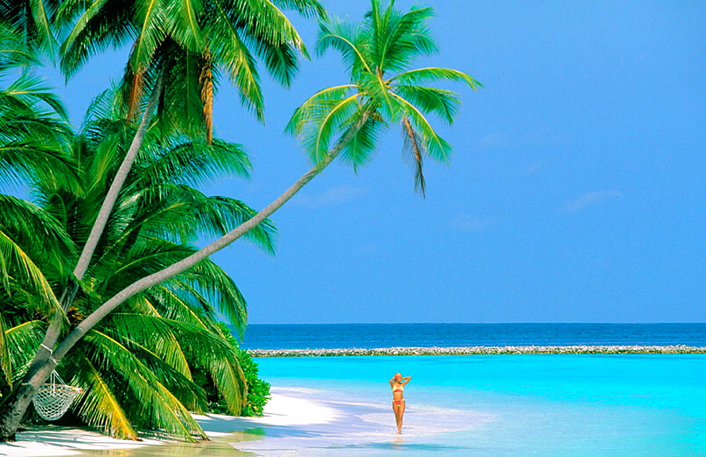 Woman on tropical beach, Maldives Islands - 817-113119
