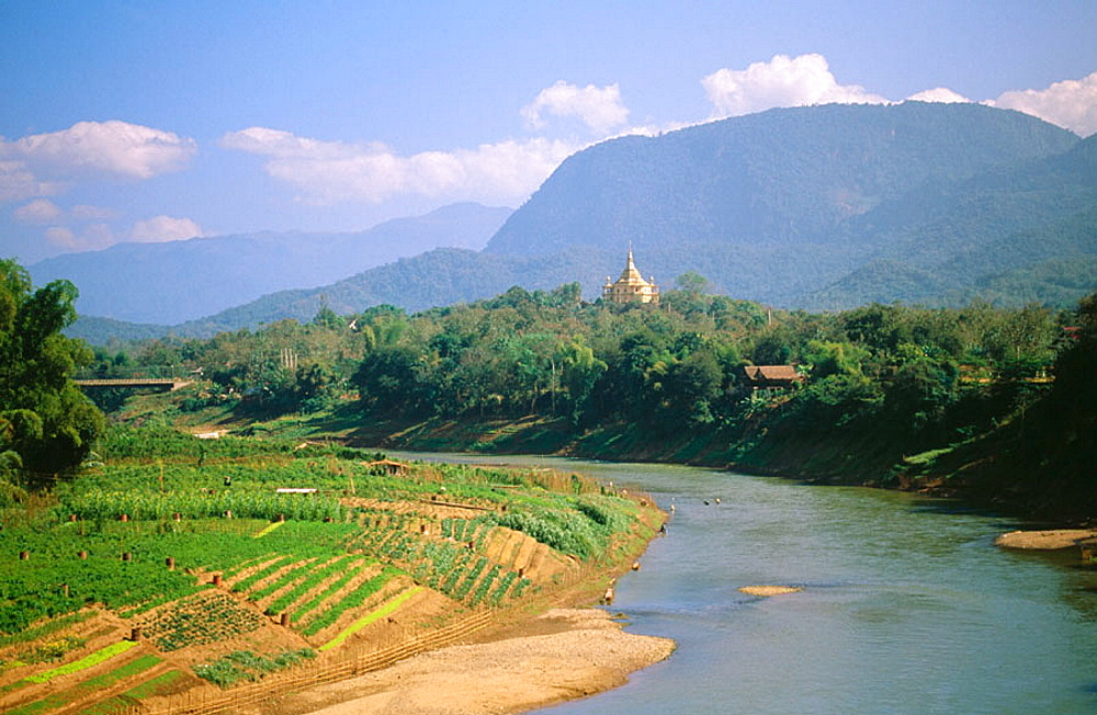 Nam Khan River and Wat Phone Phao in background, Luang Prabang, Laos