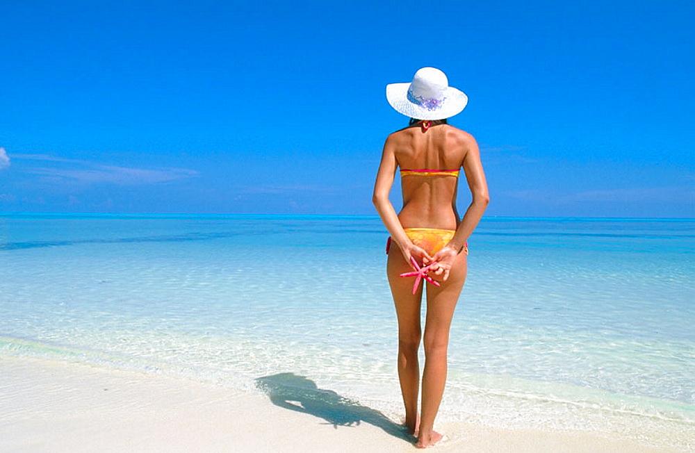 Woman on a beach in Ari Atoll, Maldives