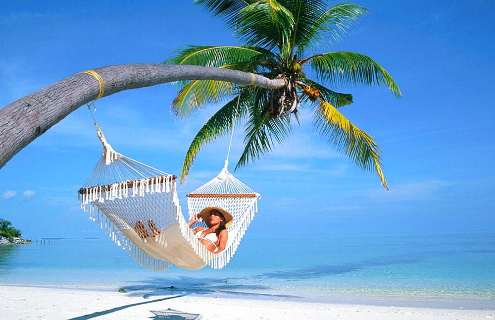 Woman on a hammock, Ari Atoll, Maldives