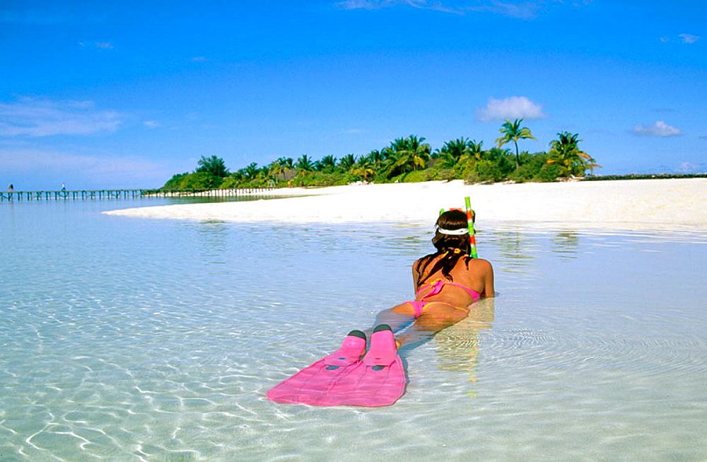 Woman on a beach, Ari Atoll, Maldives
