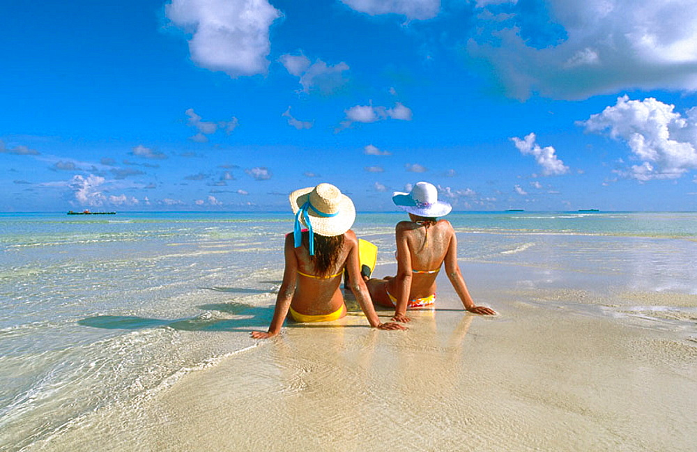 Women on the beach in White Sands Resort and Spa, Ari Atoll, Maldives - 817-113537