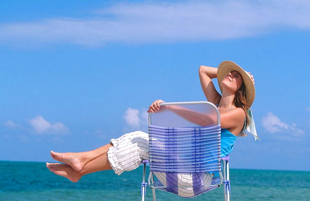Woman on beach, Miami, Florida - 817-113620