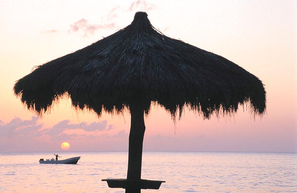 St, Lucia, Anse Chastanet Resort, Caribbean Sea, local fisherman, palm frond umbrella, sunset