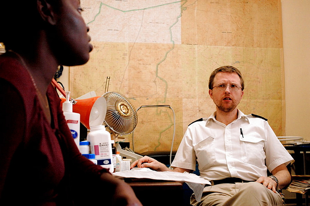 Paul Thistle, right, listens to a woman patient in his office at the Howard Hospital, Thistle is a Canadian doctor and is the the Hospital's Chief Medical Officer, The Howard Hospital is a Salvation Army operated faciltiy located in northern Zimbabwe