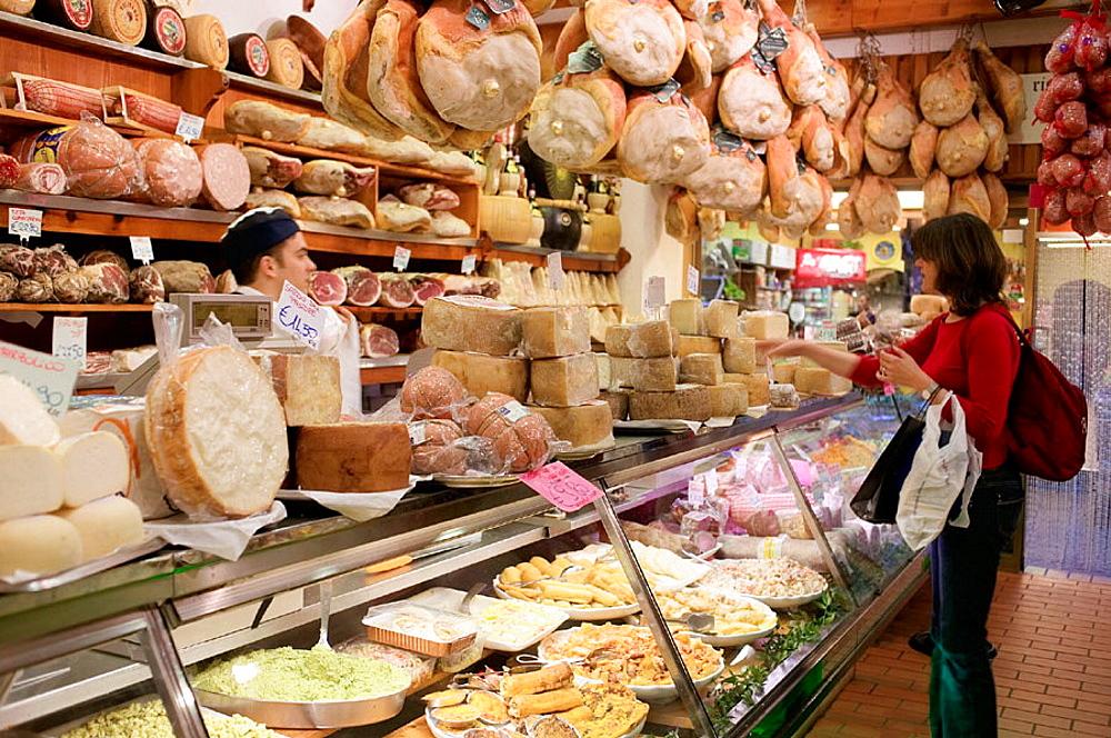 Hams and cheeses in food shop near Piazza Maggiore, Bologna, Emilia-Romagna, Italy