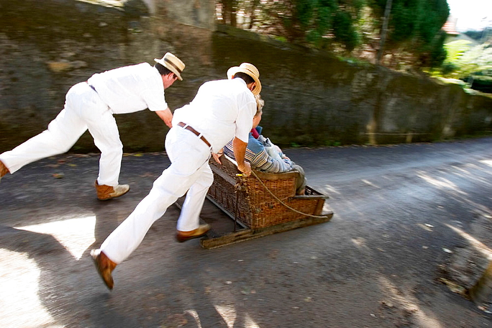Wicker-basket toboggan ride from Monte to Funchal, Madeira Island, Portugal