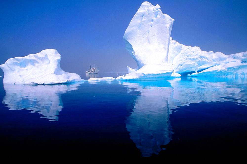 'Progressor Kromov' cruise vessel framed by iceberg, Petermann Island, Antarctica