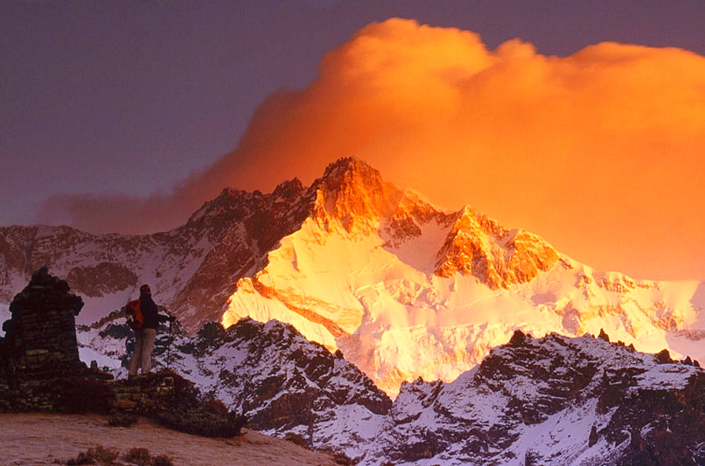 Trekker at dawn on Kangchenjunga (8595 metres), Talung face from Dzong Ri, Sikkim, India, Most easterly of the 8000 metre peaks