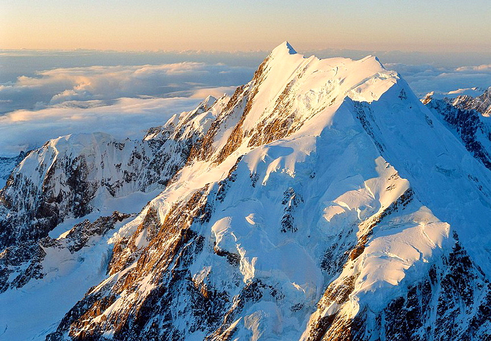 Aoraki / Mt Cook south face and Grand Traverse at sunset Mt Hicks to left Southern Alps New Zealand
