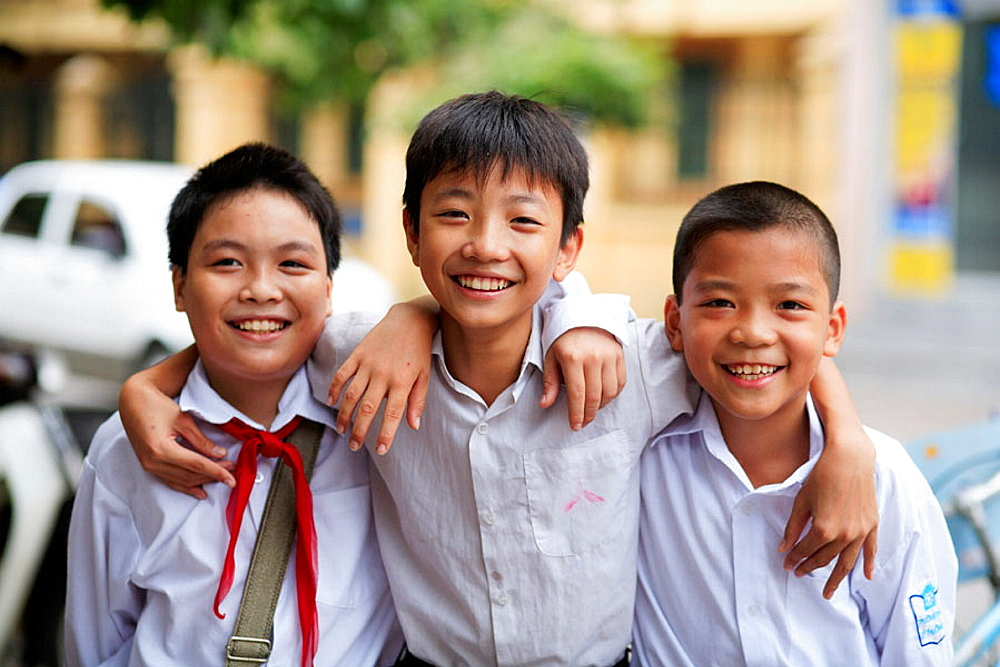 Portrait of three boys after school, The Old Quarter, Hanoi, Vietnam, Indochina, Southeast Asia, Asia 2006