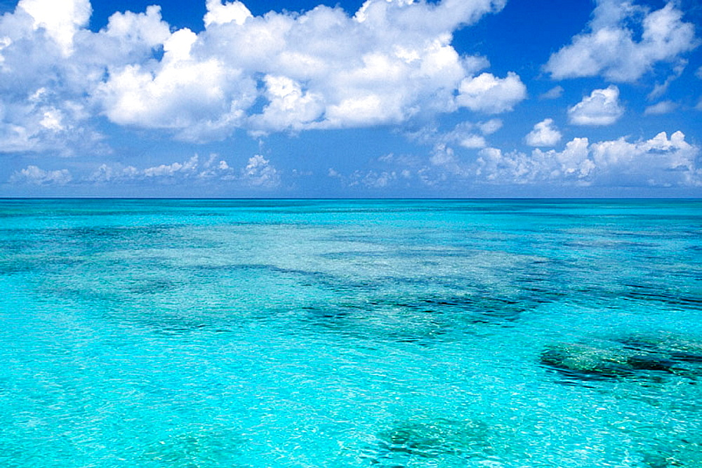 View from Grand Turk Island shore looking westerly across the varied hues of turquoise blue ocean, Turks and Caicos Islands, Caribbean