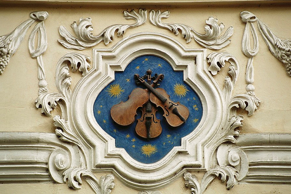 House sign in Nerudova Street, the 'Three Fiddles', Mala Strana, Prague, Czech Republic