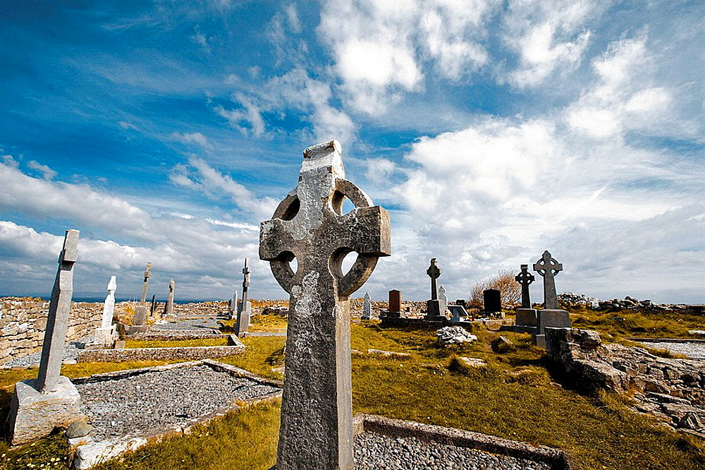 Celtic cross in Na Seacht dTeampaill (Seven Curches) graveyard celtic remains, Inishmore, biggest of Aran Islands, Galway Co, Ireland
