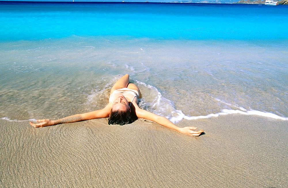 Saint Barthelemy, Caribbean, woman on beach at Colombier Bay