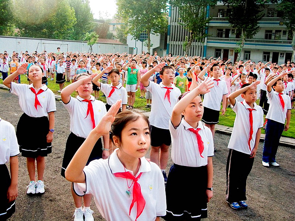 Chinese children paying homage to flag, Wuhan, Hubei, China, 2008