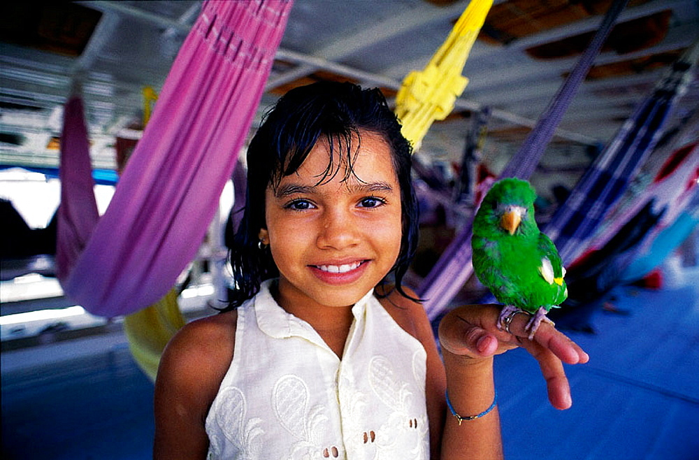Little girl with parrot on the boat from Manaus to Belem, Amazon River, Brazil - 817-122875