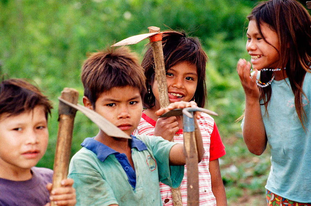 Guarani children learning to work the land, Misiones province, Argentina