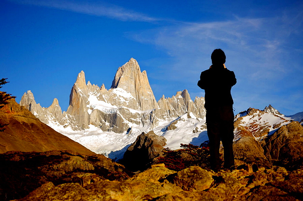 Tourist taking a picture at the Fitz Roy, Argentina