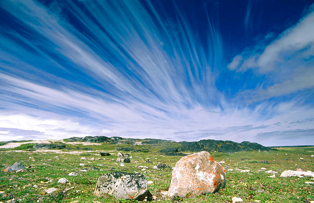 Clearing weather front with coastal tundra gravels and rocks, Hudson Bay, Churchill, Manitoba, Canada