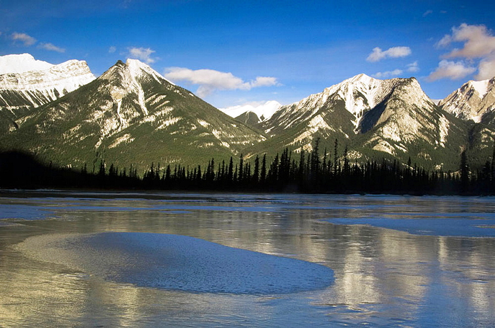 Frozen pond and SeSmet range in Jasper Flats, Alberta, Canada