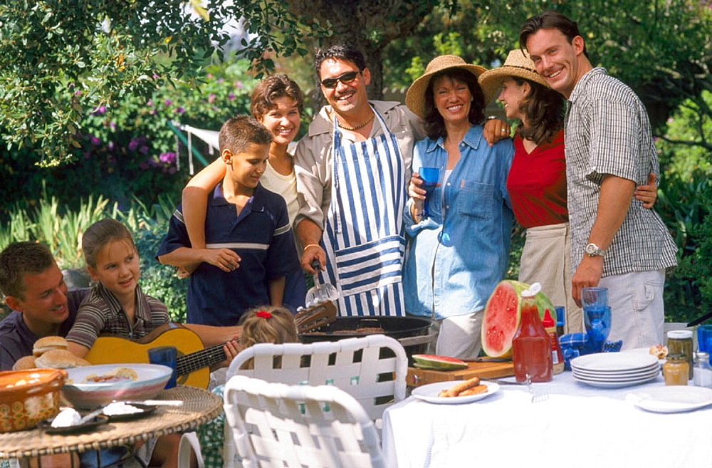 Barbecue with family, friends and neighbors in backyard