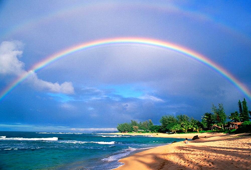 Double rainbow and evening light on Tunnels Beach, North Shore, Island of Kauai, Hawaii