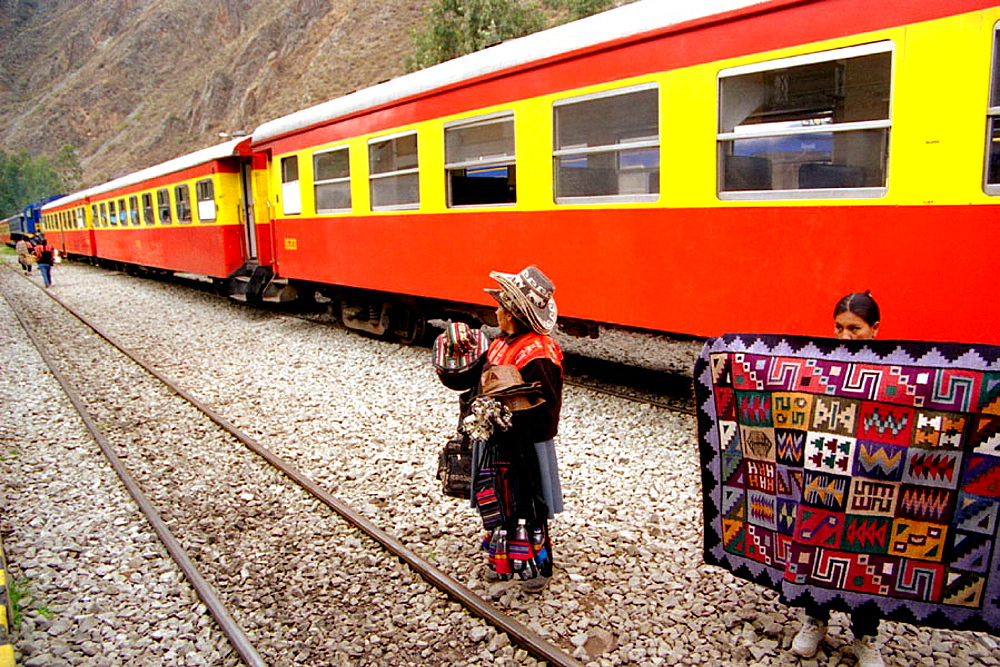 Women in front of train to Machu Picchu, Peru - 817-125056