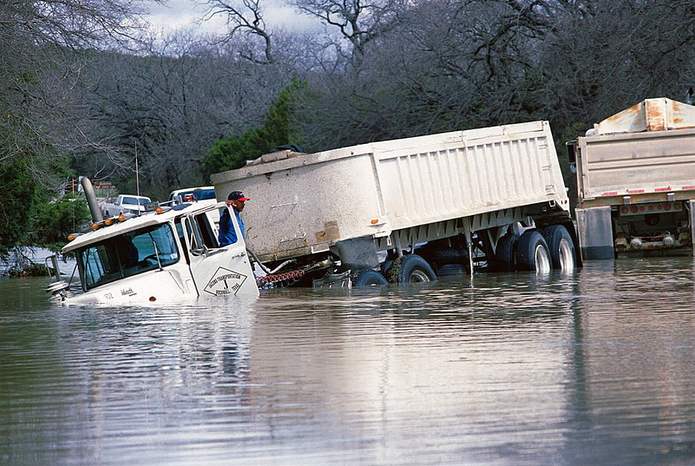 Man and truck after flood, Texas, USA