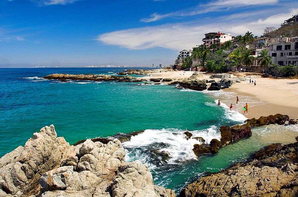 Sandy beaches with rock formations on Banderas Bay south of Puerto Vallarta, Mexico