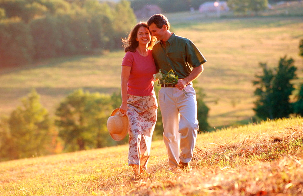 Couple strolling on a summer day in the country