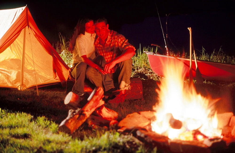 Couple by campfire