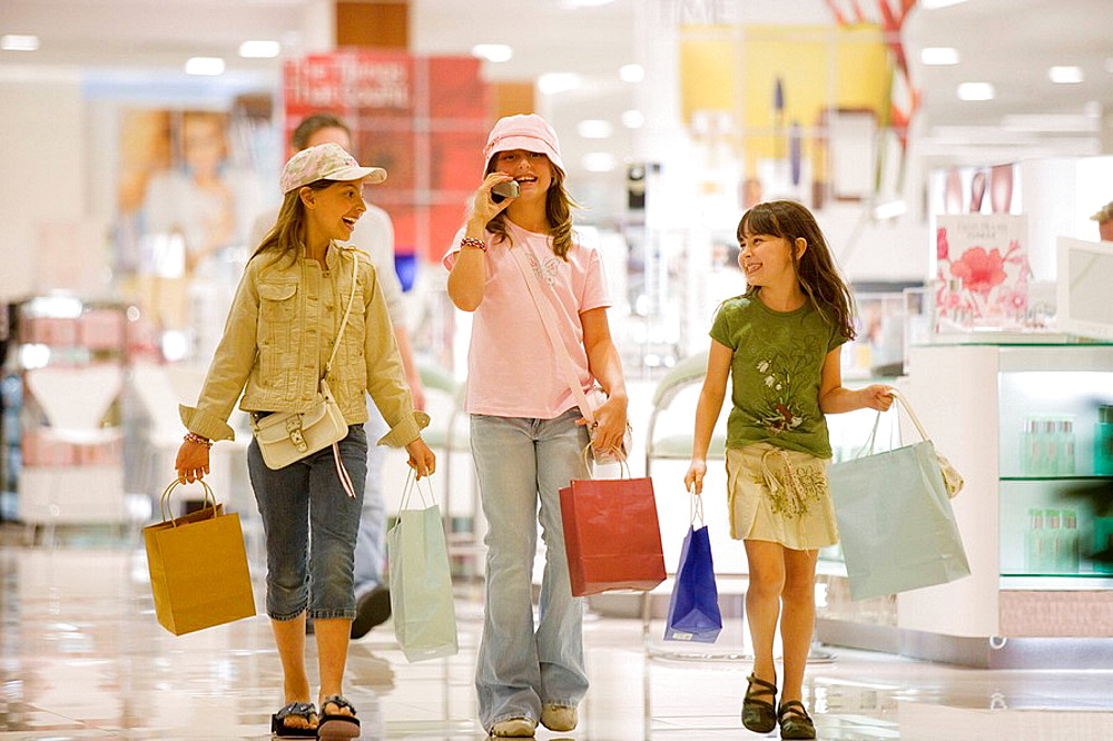caucasians, hispanic, ages 9 and 10, shopping, talking, cell phone, laughing, young consumers, mall, department store
