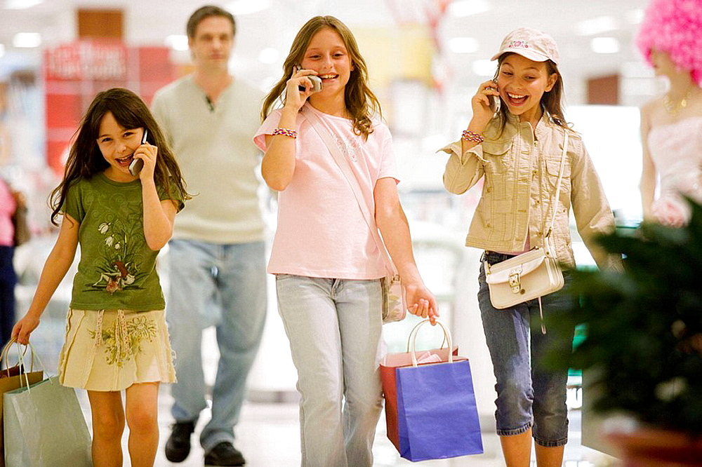 caucasians, hispanic, ages 9 and 10, cell phones,shopping, talking, laughing, happy, young consumers, dad as escort