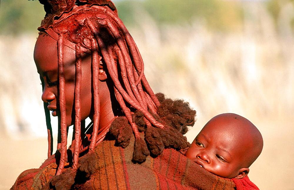 Himba wife with baby, Kaokoveld, Namibia