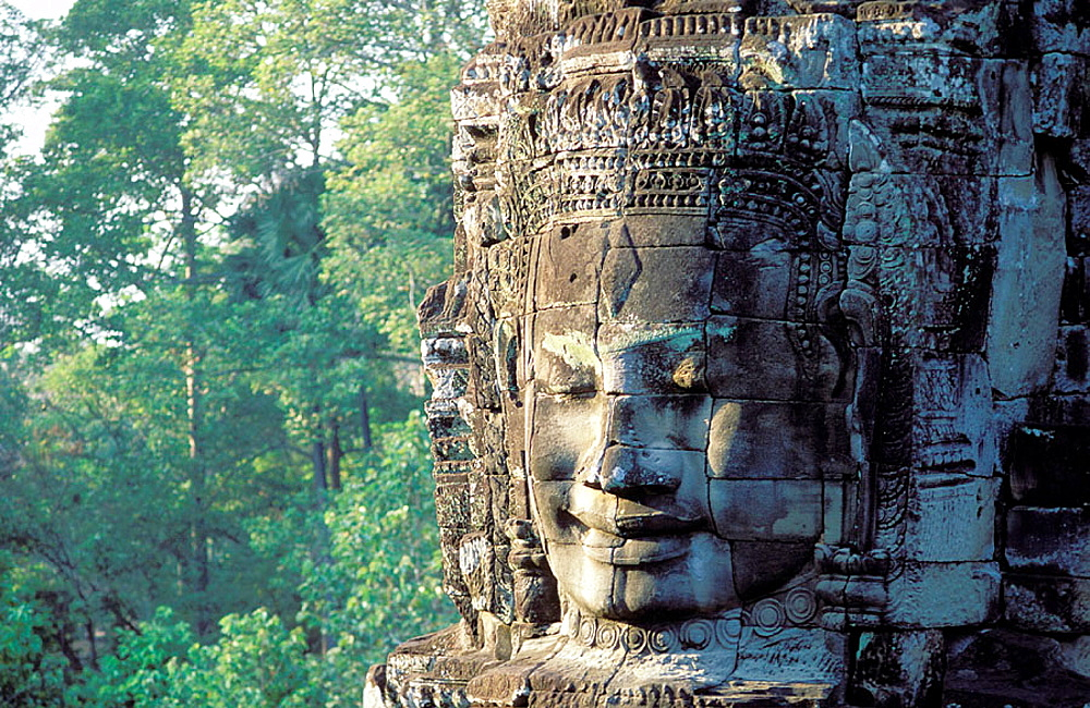 Buddha face carved in stone, Temple of Bayon, complex of Angkor Thom, Angkor, Cambodia