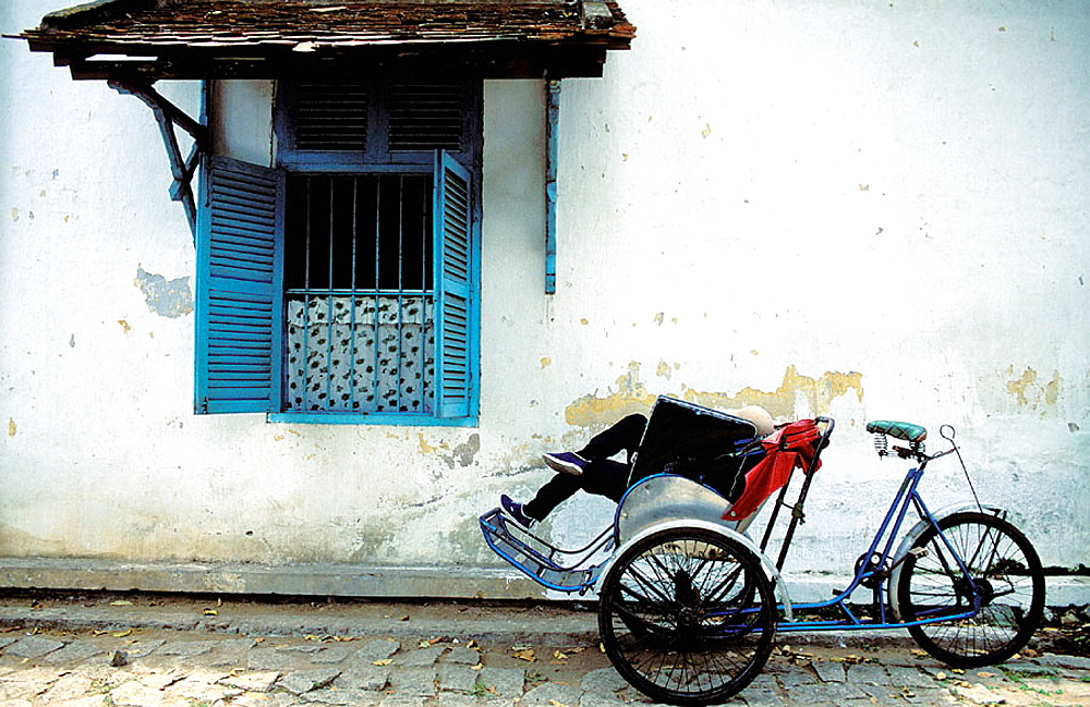 Cyclo driver having a rest, Ho Chi Minh City, Vietnam