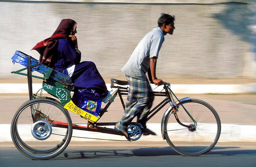 Indian man drives a rickshaw, New Delhi, India