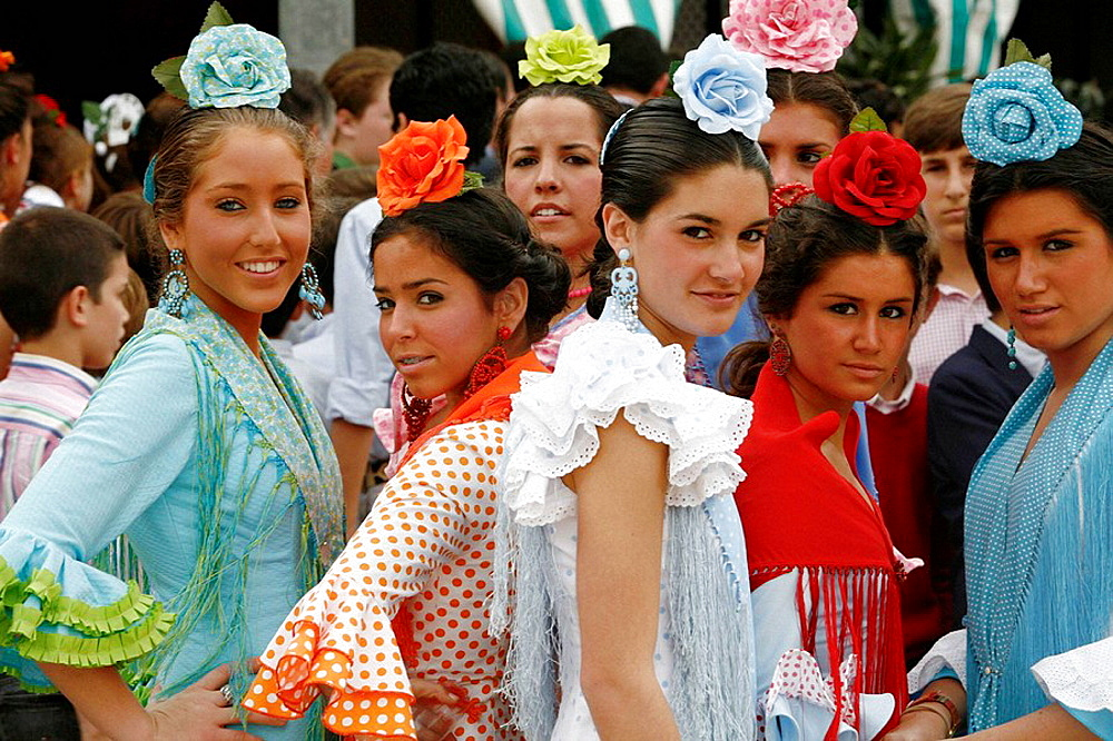 Photo of young women wearing traditional flamenco dress at the April Fair, Seville, Spain