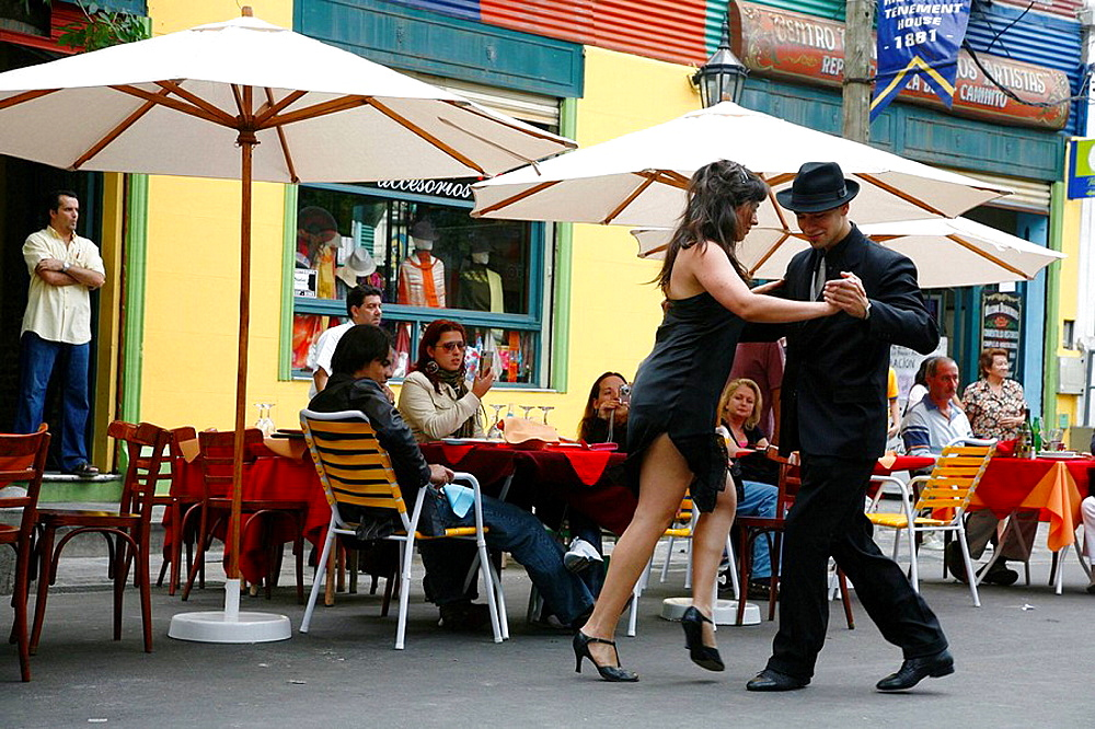 Couple dancing tango at La Boca district Buenos Aires, Argentina