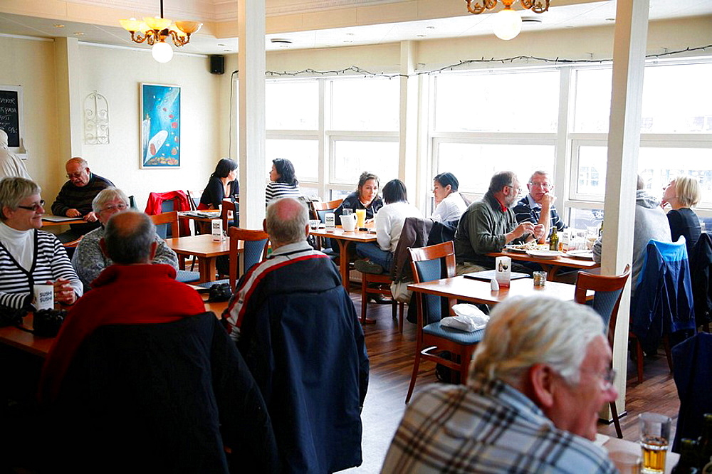 People sitting at Esmeralda Cafe and Restaurant in Nuuk, Greenalnd
