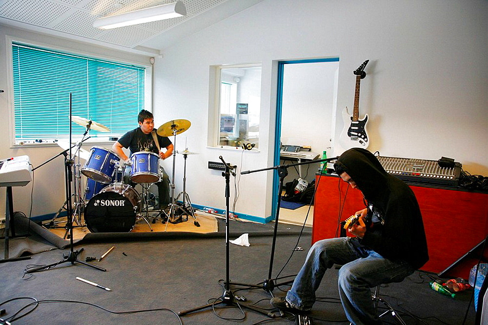Young teenagers playing music at cultural house, Nuuk,Greenland