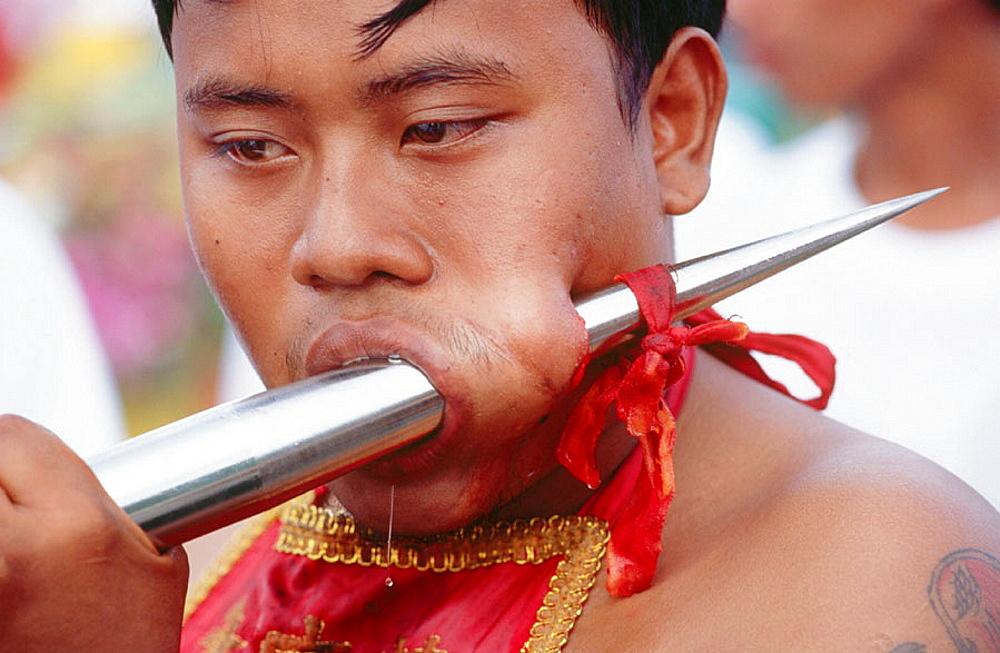 Self torturing spirit medium at the Vegetarian Festival, Phuket, South Tahiland