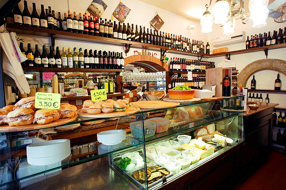 The long sales counter of a traditional cheese and wine shop offering cheese and ham sandwiches in Florence (Firenze), Tuscany, Italy, Southern Europe